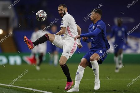 Stock Image of Real Madrid's Karim Benzema, left, challenges for the ball with Chelsea's Thiago Silva during the Champions League semifinal 2nd leg soccer match between Chelsea and Real Madrid at Stamford Bridge in London