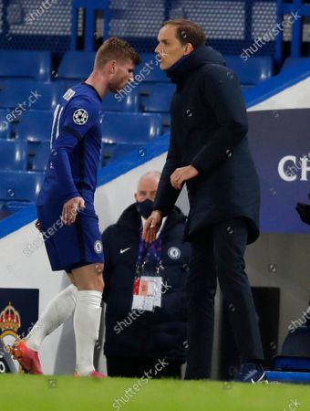 Chelsea's Timo Werner shakes hand with Chelsea's head coach Thomas Tuchel as he leaves the pitch during the Champions League semifinal 2nd leg soccer match between Chelsea and Real Madrid at Stamford Bridge in London