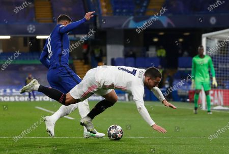 Real Madrid's Eden Hazard, right, is tackled by Chelsea's Thiago Silva during the Champions League semifinal 2nd leg soccer match between Chelsea and Real Madrid at Stamford Bridge in London