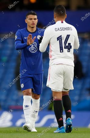 Chelsea's Thiago Silva, cheers with Real Madrid's Casemiro prior to the start of the Champions League semifinal 2nd leg soccer match between Chelsea and Real Madrid at Stamford Bridge in London