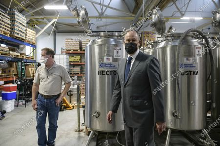 Doug Emhoff, right, listens to Mike Manning of the Colony Meadery during a tour of the Bridgeworks Enterprise Center, a small business incubator, Wednesday, in Allentown, Pa