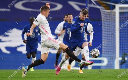 Timo Werner (R) of Chelsea in action against Toni Kroos of Real Madrid during the UEFA Champions League semi final, second leg soccer match between Chelsea FC and Real Madrid in London, Britain, 05 May 2021.