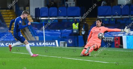 Timo Werner (L) of Chelsea scores against Real Madrid goalkeeper Thibaut Courtois but the goal was disallowed for offside during the UEFA Champions League semi final, second leg soccer match between Chelsea FC and Real Madrid in London, Britain, 05 May 2021.