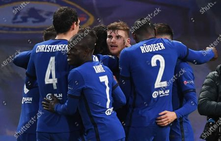 Timo Werner (facing) of Chelsea celebrates with teammates after scoring the opening goal during the UEFA Champions League semi final, second leg soccer match between Chelsea FC and Real Madrid in London, Britain, 05 May 2021.