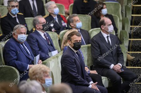 French President Emmanuel Macron (C-L) and his wife Brigitte (C-R) listen to speeches at the Academie Francaise on May 5, 2021 in Paris, surrounded by (From L) President of the French Senate Gerard Larcher, National Assembly President Richard Ferrand, formed French President Nicolas Sarkozy and French Prime Minister Jean Castex during the commemoration of the 200th anniversary of Nantes apoleon's death.
