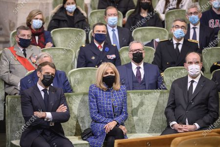 Stock Photo of French President Emmanuel Macron (C-L) and his wife Brigitte (C-R) listen to speeches at the Academie Francaise on May 5, 2021 in Paris, surrounded by (From L) President of the French Senate Gerard Larcher, National Assembly President Richard Ferrand, formed French President Nicolas Sarkozy and French Prime Minister Jean Castex during the commemoration of the 200th anniversary of Nantes apoleon's death.