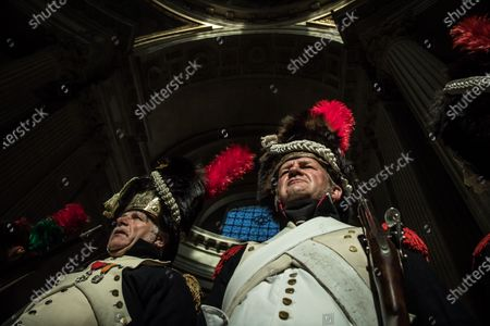 French reenactors dressed as Imperial Guard Grenadiers stand guard at Napoleon's tomb prior to a ceremony in homage to the French Emperor for the bicentenary of his death under the dome of Saint-Louis cathedral in the Invalides in Paris, France, 05 May 2021. 200 years ago, French military and political leader Napoleon Bonaparte (1769-1821) died in exile on the island of Saint Helena on 05 May 1821. Official commemorations of the bicentenary of his death spark controversy in France among those who consider him to represent a dark part of the country's history and those who support his legacy.