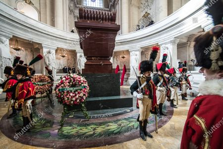Stock Picture of French reenactors dressed as Hussars of the Imperial Guard stand guard at Napoleon's tomb prior to a ceremony in homage to the French Emperor for the bicentenary of his death under the dome of Saint-Louis cathedral in the Invalides in Paris, France, 05 May 2021. 200 years ago, French military and political leader Napoleon Bonaparte (1769-1821) died in exile on the island of Saint Helena on 05 May 1821. Official commemorations of the bicentenary of his death spark controversy in France among those who consider him to represent a dark part of the country's history and those who support his legacy.