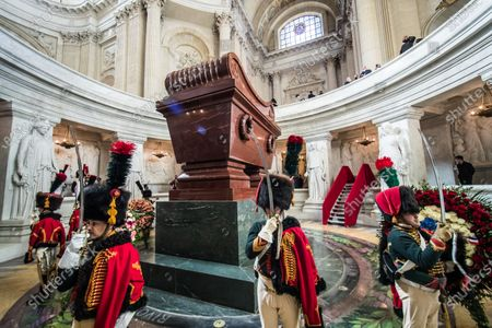 Stock Photo of French reenactors dressed as Hussars of the Imperial Guard stand guard at Napoleon's tomb during a ceremony in homage to the French Emperor for the bicentenary of his death under the dome of Saint-Louis cathedral in the Invalides in Paris, France, 05 May 2021. 200 years ago, French military and political leader Napoleon Bonaparte (1769-1821) died in exile on the island of Saint Helena on 05 May 1821. Official commemorations of the bicentenary of his death spark controversy in France among those who consider him to represent a dark part of the country's history and those who support his legacy.