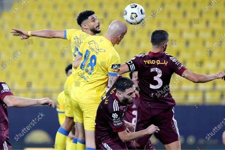 Al-Nassr's players Abdulelah Alamri (L) and Maicon (2-L) vie for the ball with Al-Faisaly's Igor Rossi (R) during the Saudi Professional League soccer match between Al-Nassr and Al-Faisaly at Mrsool Park Stadium, Riyadh, Saudi Arabia, 05 May 2021.
