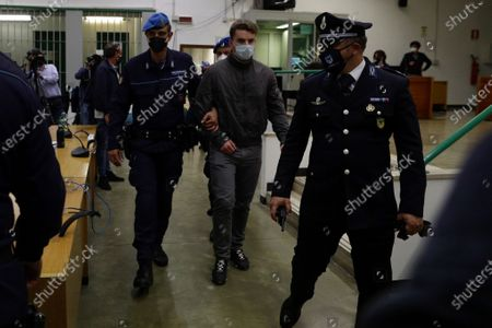Stock Image of Gabriel Natale-Hjorth, center, is escorted by police officers during the trial for the slaying of an Italian plainclothes police officer, in Rome, . A jury in Rome has convicted two American friends in the 2019 slaying of a police officer in a drug sting gone awry, sentencing them to life in prison. The jury delivered more than 12 hours before delivering the verdicts late Tuesday against 21-year-old Finnegan Lee Elder and 20-year-old Gabriel Natale