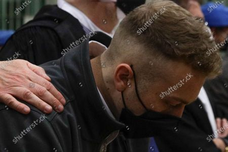 Finnegan Lee Elder listens as the verdict is read, in the trial for the slaying of an Italian plainclothes police officer, in Rome, . A jury in Rome on Wednesday convicted two American friends in the 2019 slaying of a police officer in a drug sting gone awry, sentencing them to life in prison. The jury deliberated more than 12 hours before delivering the verdicts against Finnegan Lee Elder, 21, and Gabriel Natale Hjorth, 20, handing them Italy's stiffest sentence