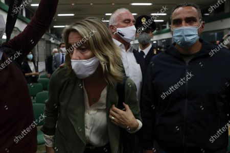 Ethan Elder, center, and his wife Leah Lynn Elder, left, parents of Finnegan Lee Elder, react during the trial for the slaying of an Italian plainclothes police officer, in Rome, . A jury in Rome has convicted two American friends in the 2019 slaying of a police officer in a drug sting gone awry, sentencing them to life in prison. The jury delivered more than 12 hours before delivering the verdicts late Tuesday against 21-year-pld Finnegan Lee Elder and 20-year-old Gabriel Natale