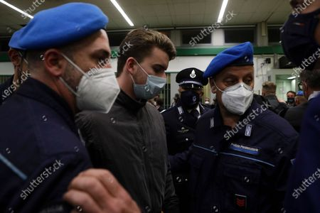 Gabriel Natale-Hjorth is escorted by police officers during the trial for the slaying of an Italian plainclothes police officer in summer 2019, in Rome, . A jury in Rome has convicted two American friends in the 2019 slaying of a police officer in a drug sting gone awry, sentencing them to life in prison. The jury delivered more than 12 hours before delivering the verdicts late Tuesday against 21-year-old Finnegan Lee Elder and 20-year-old Gabriel Natale