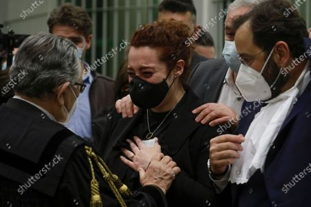 Rosa Maria Esilio, right, widow of Italian Carabinieri paramilitary police officer Mario Cerciello Rega, reacts during the trial in Rome, . A jury in Rome has convicted two American friends in the 2019 slaying of a police officer in a drug sting gone awry, sentencing them to life in prison. The jury delivered more than 12 hours before delivering the verdicts late Tuesday against 21-year-old Finnegan Lee Elder and 20-year-old Gabriel Natale