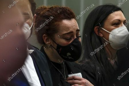 Rosa Maria Esilio, right, widow of Italian Carabinieri paramilitary police officer Mario Cerciello Rega, reacts as she listens to the verdict in the trial in which two American tourists are accused of murdering her husband, in Rome, . A jury in Rome has convicted two American friends in the 2019 slaying of a police officer in a drug sting gone awry, sentencing them to life in prison. The jury delivered more than 12 hours before delivering the verdicts late Tuesday against 21-year-old Finnegan Lee Elder and 20-year-old Gabriel Natale