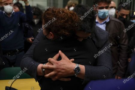 Rosa Maria Esilio, back to camera, widow of Italian Carabinieri paramilitary police officer Mario Cerciello Rega, is hugged by Paolo, the brother of Mario Cerciello Rega, after listening to the verdict in the trial in which two American tourists are accused of murdering her husband, in Rome, . A jury in Rome has convicted two American friends in the 2019 slaying of a police officer in a drug sting gone awry, sentencing them to life in prison. The jury delivered more than 12 hours before delivering the verdicts late Tuesday against 21-year-old Finnegan Lee Elder and 20-year-old Gabriel Natale