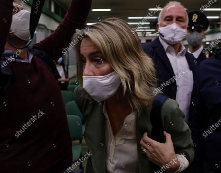 Ethan Elder, right, and his wife Leah Lynn Elder, parents of Finnegan Lee Elder, react after listening to the verdict in the trial for the slaying of an Italian plainclothes police officer, in Rome, . A jury in Rome has convicted two American friends in the 2019 slaying of a police officer in a drug sting gone awry, sentencing them to life in prison. The jury delivered more than 12 hours before delivering the verdicts late Tuesday against 21-year-old Finnegan Lee Elder and 20-year-old Gabriel Natale