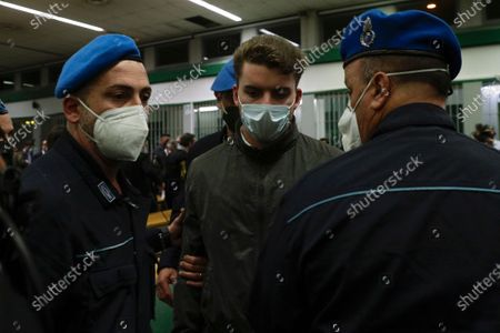 Gabriel Natale-Hjorth is escorted by police officers during the trial for the slaying of an Italian plainclothes police officer in Rome in summer 2019, in Rome, . A jury in Rome has convicted two American friends in the 2019 slaying of a police officer in a drug sting gone awry, sentencing them to life in prison. The jury delivered more than 12 hours before delivering the verdicts late Tuesday against 21-year-old Finnegan Lee Elder and 20-year-old Gabriel Natale