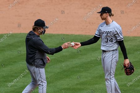 Chicago White Sox Tony La Russa, left, takes the ball from Michael Kopech during a baseball game against the Cincinnati Reds, . The Reds won 1-0