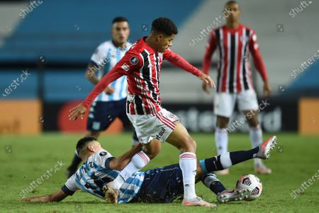 Luciano of Brazil's Sao Paulo, above, and Mauricio Martinez of Argentina's Racing Club battle for the ball during a Copa Libertadores soccer match in Buenos Aires, Argentina