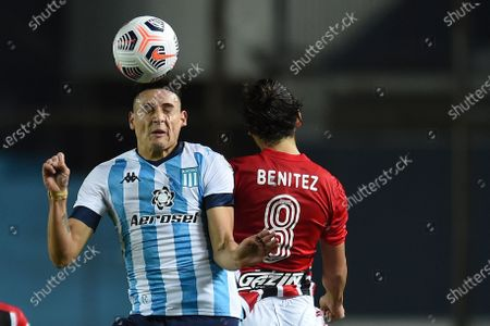 Mauricio Martinez of Argentina's Racing Club, left, and Marti Benitez of Brazil's Sao Paulo go for a header during a Copa Libertadores soccer match in Buenos Aires, Argentina