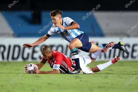 Racing Club's Ivan Gabriel Maggi (up) in action against Sao Paulo's Joao Miranda, during the Group E match of the Copa Libertadores between Racing Club and Sao Paulo, at the Presidente Peron 'El Cilindro' stadium, in Avellaneda, Argentina, 05 May 2021.