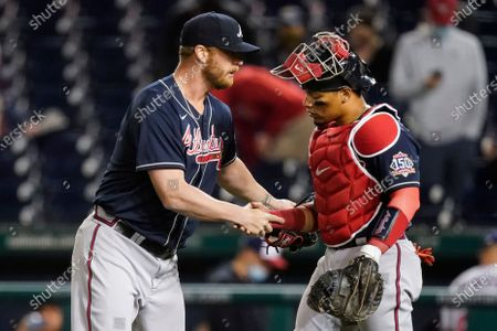Atlanta Braves relief pitcher Will Smith, left, and catcher William Contreras celebrate after the team's baseball game against the Washington Nationals at Nationals Park, in Washington. The Braves won 5-3