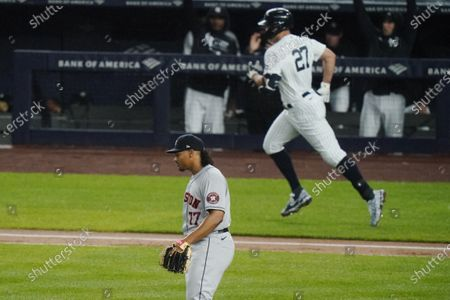 Houston Astros starting pitcher Luis Garcia (77) reacts as New York Yankees' Giancarlo Stanton (27) runs the bases after hitting a two-run home run during the third inning of a baseball game, in New York