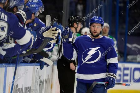Stock Image of Tampa Bay Lightning center Tyler Johnson (9) celebrates with the bench after his goal against the Dallas Stars during the first period of an NHL hockey game, in Tampa, Fla