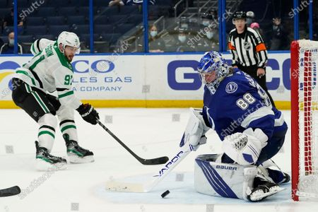 Tampa Bay Lightning goaltender Andrei Vasilevskiy (88) makes a save on a shot by Dallas Stars center Tyler Seguin (91) during the third period of an NHL hockey game, in Tampa, Fla