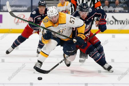 Nashville Predators' Dante Fabbro, left, and Columbus Blue Jackets' Cam Atkinson chase the puck during the second period of an NHL hockey game, in Columbus, Ohio