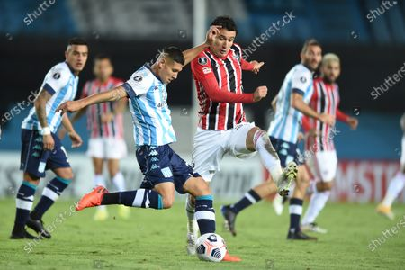Racing Club's Juan Jose Caceres (L) in action against Sao Paulo's Pablo Felipe Teixeira, during the Group E match of the Copa Libertadores between Racing Club and Sao Paulo, at the Presidente Peron 'El Cilindro' stadium, in Avellaneda, Argentina, 05 May 2021.