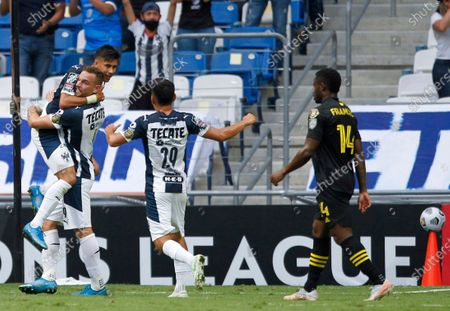 Maximiliano Meza of Mexico's Monterrey, left, is congratulated by his teammates after scoring his team's second goal against Unites States' Columbus Crew in a Concacaf Champions League soccer game in Leon, Mexico, in Monterrey