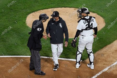 Stock Photo of Chicago White Sox manager Tony La Russa, center, argues with home plate umpire Gabe Morales (47) while catcher Yasmani Grandal (24) listens during the ninth inning of the team's baseball against the Cleveland Indians in Chicago. La Russa developed a reputation as a master strategist while managing the Oakland Athletics to a World Series championship and the St. Louis Cardinals to two more. His second tenure with the Chicago White Sox is off to a bumpy start