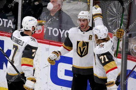 Vegas Golden Knights right wing Reilly Smith (19) is congratulated by defenseman Alex Pietrangelo (7) and center William Karlsson (71) after scoring a goal against the Minnesota Wild during the third period of an NHL hockey game, in St. Paul, Minn. The Golden Knights won 3-2 in overtime