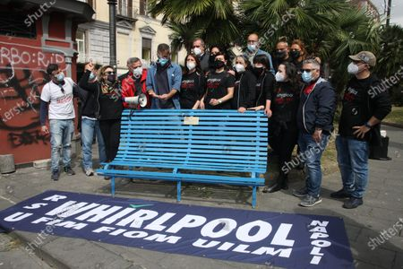 """A blue bench for workers in difficulty. the initiative proposed by the workers of WHIRLPOOLl and accepted by the municipal administration of Naples. On it is affixed a plate with the iconic engraved extract from article 1 of the Constitution which reads """"L'Italia è una Repubblica democratica fondata sul lavoro"""".In picture Luigi De Magistris,mayor of Naples and WHIRLPOOL worker's"""