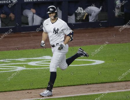 New York Yankees Giancarlo Stanton hits a 2-run home run in the third inning against the Houston Astros at Yankee Stadium on Wednesday, May 5, 2021 in New York City.