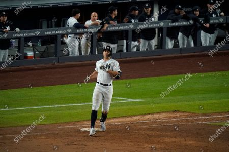 New York Yankees' Giancarlo Stanton reaches first base for a single during the eighth inning of a baseball game against the Houston Astros, in New York. The Yankees won 6-3