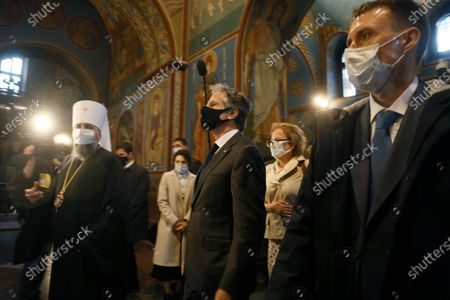 Secretary of State Antony Blinken, centre, accompanied by the Head of the Independent Ukrainian Church Metropolitan Epiphanius, left, visit the Mikhailovsky Zlatoverkhy Cathedral (St. Michael's Golden-Domed Cathedral) in Kyiv, Ukraine, . Blinken is in Kyiv on Thursday, meeting top Ukrainian officials during a one-day visit that is highly anticipated in the country as it faces heightened tensions with Russia