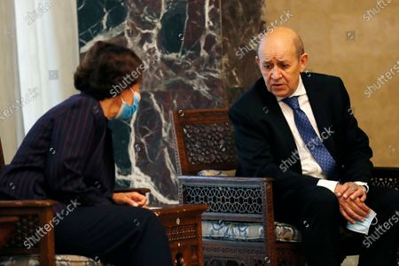 French Foreign Minister Jean-Yves Le Drian, right, speaks with the French Ambassador to Lebanon Anne Grillo, left, during his meeting with Lebanese President Michel Aoun at the Presidential Palace in Baabda, east of Beirut, Lebanon, . Le Drian is in Beirut for two days visit to meet with Lebanese officials