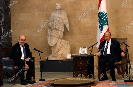 French Foreign Minister Jean-Yves Le Drian, left, meets with Lebanese President Michel Aoun at the Presidential Palace in Baabda, east of Beirut, Lebanon, . Le Drian is in Beirut for two days visit to meet with Lebanese officials