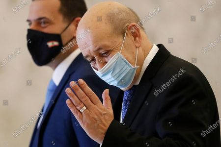 French Foreign Minister Jean-Yves Le Drian salutes journalists as he leaves the Presidential Palace after his meeting with Lebanese President Michel Aoun, in Baabda, east of Beirut, Lebanon, . Le Drian is in Beirut for two days visit to meet with Lebanese officials