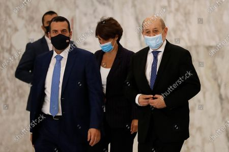 """French Foreign Minister Jean-Yves Le Drian, right, leaves the Presidential Palace after his meeting with Lebanese President Michel Aoun in Baabda, east of Beirut, Lebanon, . Le Drian began a visit to Lebanon Thursday with a message of """"great firmness"""" to its political leaders, threatening to take additional measures against officials obstructing the formation of a government in the crisis-hit country"""