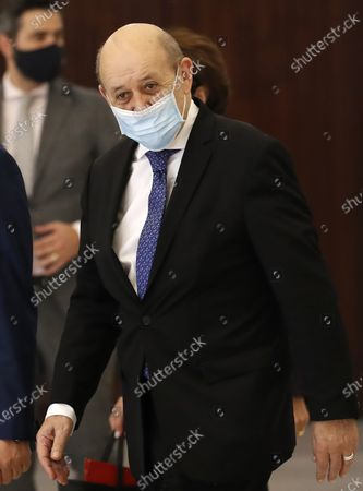 """French Foreign Minister Jean-Yves Le Drian, leaves the Presidential Palace after his meeting with Lebanese President Michel Aoun in Baabda, east of Beirut, Lebanon, . Le Drian began a visit to Lebanon Thursday with a message of """"great firmness"""" to its political leaders, threatening to take additional measures against officials obstructing the formation of a government in the crisis-hit country"""