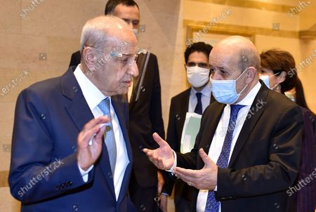 """In this photo released by the Lebanese Parliament media office, Lebanese French Foreign Minister Jean-Yves Le Drian, right, speaks with Lebanese Parliament Speaker Nabih Berri, in Beirut, Lebanon, . Le Drian began a visit to Lebanon Thursday with a message of """"great firmness"""" to its political leaders, threatening to take additional measures against officials obstructing the formation of a government in the crisis-hit country"""