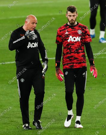 Goalkeeping coach Richard Hartis gives Manchester United goalkeeper David De Gea some instructions