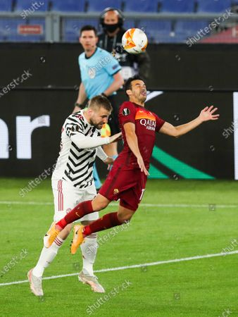 Stock Photo of Luke Shaw of Manchester United and Pedro of Roma