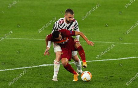 Stock Image of Luke Shaw of Manchester United and Pedro of Roma