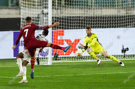 Stock Photo of Manchester United goalkeeper David De Gea saves from Lorenzo Pellegrini of Roma